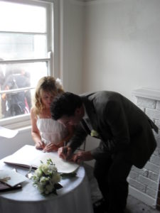Signing the Marriage register at Nobbys Lighthouse